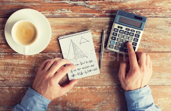 Ręce Kalkulator zadanie działalności edukacji Zdjęcia stock © dolgachov