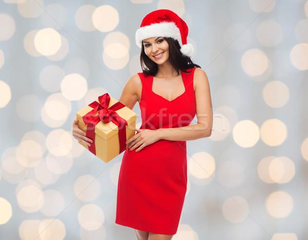 Gyönyörű szexi nő mikulás kalap ajándék doboz emberek Stock fotó © dolgachov