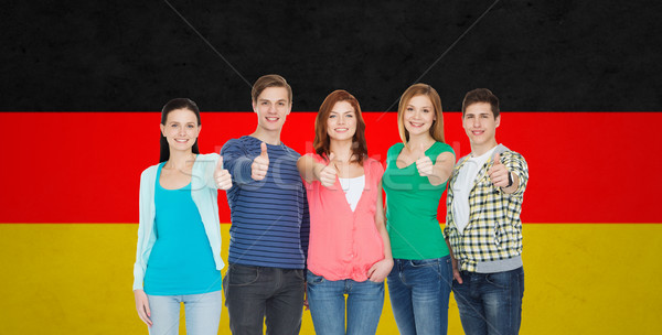 group of smiling students showing thumbs up Stock photo © dolgachov