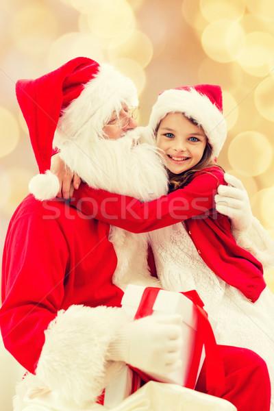 Mosolyog kislány mikulás ünnepek karácsony gyermekkor Stock fotó © dolgachov