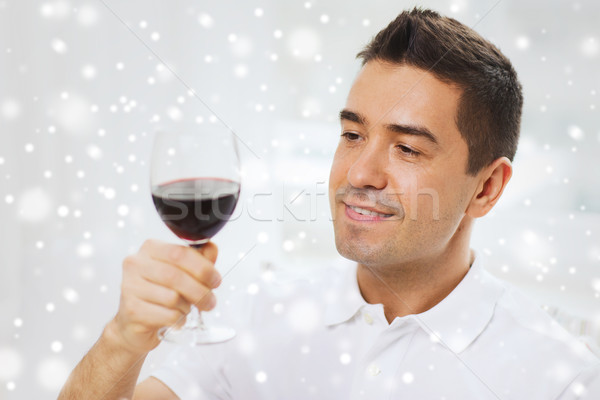 happy man drinking red wine from glass Stock photo © dolgachov