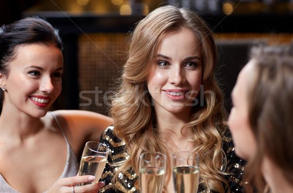 Mutlu kadın şampanya gözlük gece klübü kutlama Stok fotoğraf © dolgachov