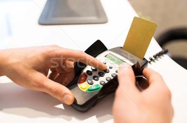 hand entering pin code to bank terminal Stock photo © dolgachov