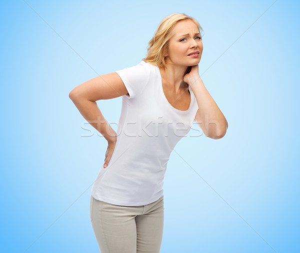 unhappy middle aged woman suffering from backache Stock photo © dolgachov