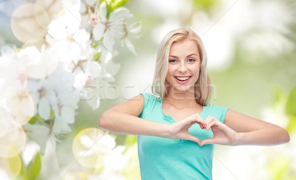 happy woman or teen girl showing heart shape sigh Stock photo © dolgachov