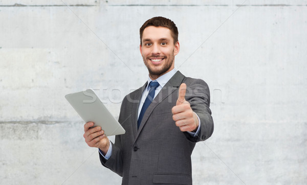 young businessman with tablet pc showing thumbs up Stock photo © dolgachov