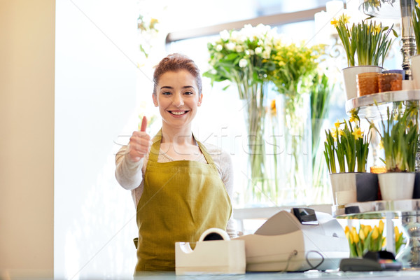 florist woman at flower shop showing thumbs up  Stock photo © dolgachov
