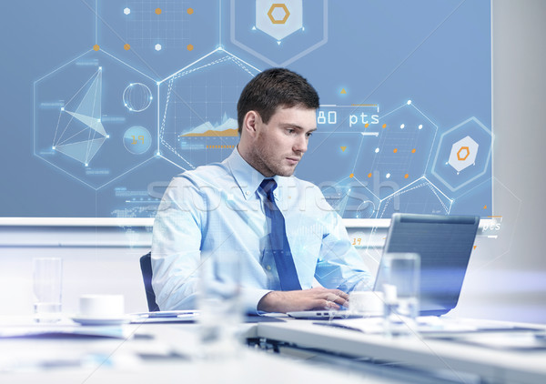 businessman with laptop working in office Stock photo © dolgachov