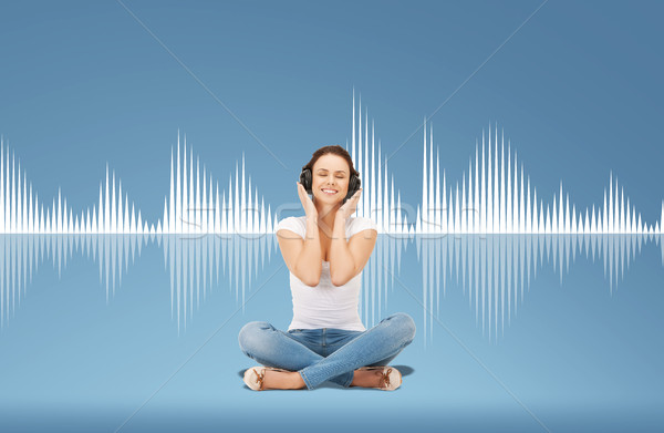 smiling young woman or teen girl in headphones Stock photo © dolgachov
