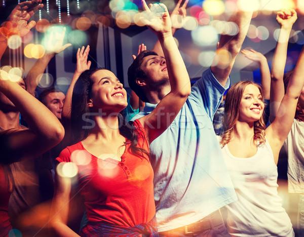 Sonriendo amigos concierto club fiesta vacaciones Foto stock © dolgachov