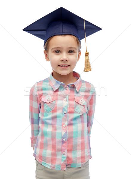 happy girl in bachelor hat or mortarboard Stock photo © dolgachov