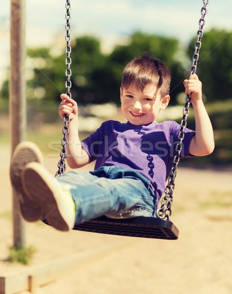 幸せ 少年 スイング 遊び場 夏 ストックフォト © dolgachov