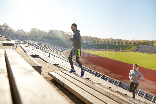 happy couple running upstairs on stadium Stock photo © dolgachov