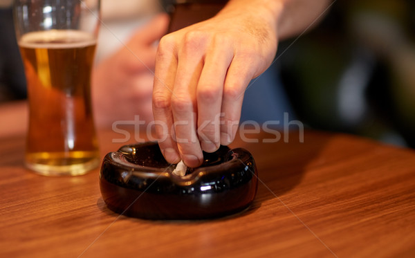 close up of hand extinguish cigarette in ashtray Stock photo © dolgachov