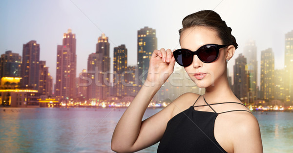 beautiful young woman in elegant black sunglasses Stock photo © dolgachov