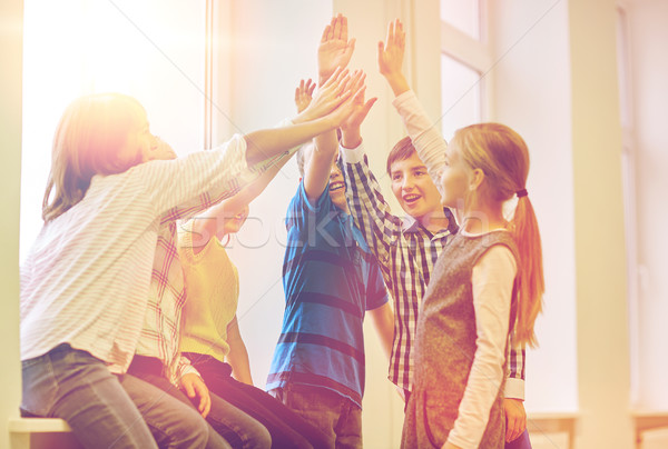 Grupo sorridente escolas crianças high five Foto stock © dolgachov