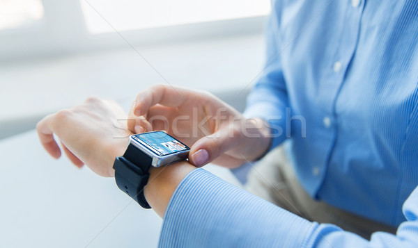 close up of hands with business news on smartwatch Stock photo © dolgachov