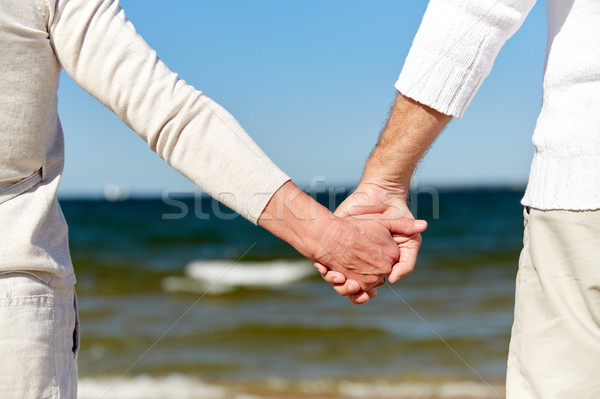 Stockfoto: Holding · handen · strand · familie · leeftijd