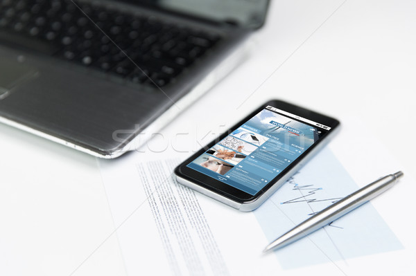 close up of smartphone with business news page Stock photo © dolgachov