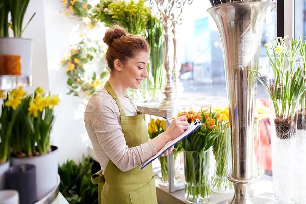 Virágárus nő vágólap virágüzlet emberek vásár Stock fotó © dolgachov