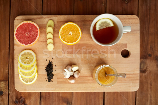 Zencefil çay bal narenciye sarımsak ahşap Stok fotoğraf © dolgachov