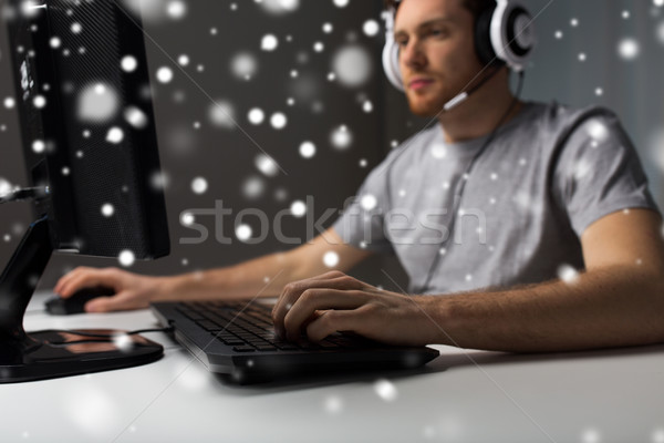 man with headset playing computer video game Stock photo © dolgachov