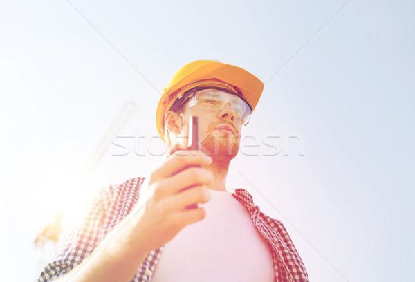 builder in hardhat with radio Stock photo © dolgachov