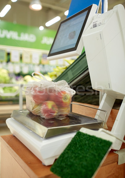 apples in plastic bag on scale at grocery store Stock photo © dolgachov