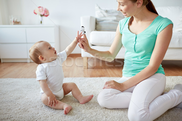 happy mother and baby playing at home Stock photo © dolgachov