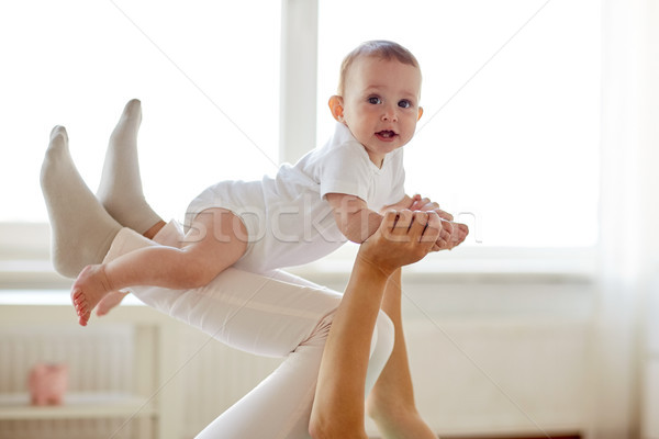 mother playing with baby at home Stock photo © dolgachov