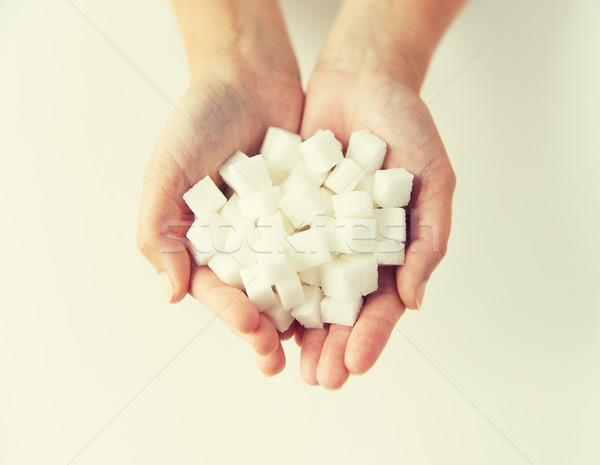 close up of white lump sugar in woman hands Stock photo © dolgachov