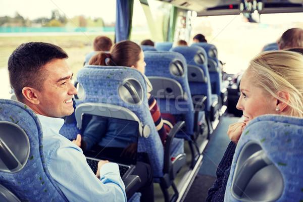 Grupo feliz passageiros viajar ônibus transporte Foto stock © dolgachov