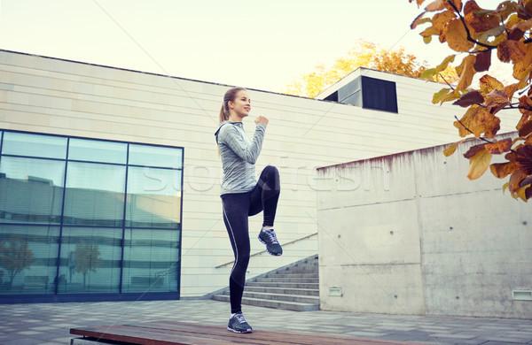 Boldog nő testmozgás pad kint fitnessz Stock fotó © dolgachov