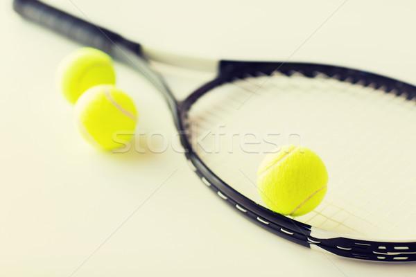 close up of tennis racket with balls Stock photo © dolgachov