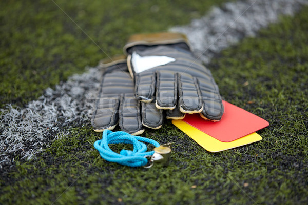 gloves, whistle and caution cards on soccer field Stock photo © dolgachov