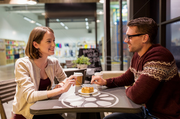 happy couple eating cake for dessert at cafe Stock photo © dolgachov