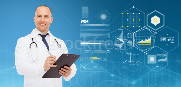 doctor with clipboard, stethoscope and charts Stock photo © dolgachov