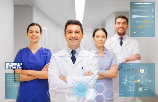 Gelukkig groep artsen ziekenhuis mensen gezondheidszorg Stockfoto © dolgachov