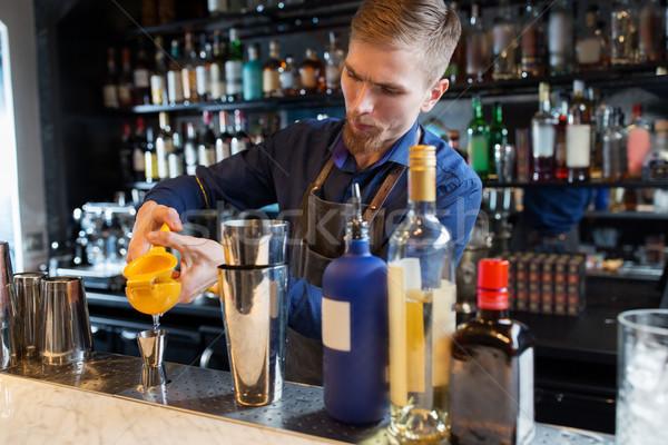barman with shaker, alcohol and jigger at bar Stock photo © dolgachov