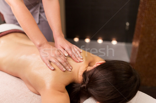 woman lying and having back massage at spa parlor Stock photo © dolgachov