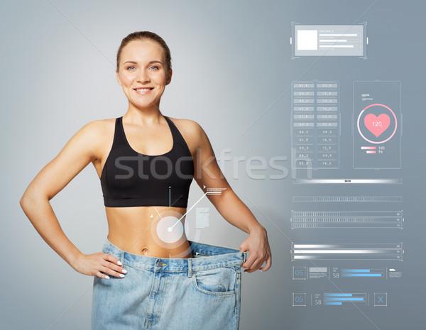 Fiatal karcsú sportos nő nagy méret Stock fotó © dolgachov