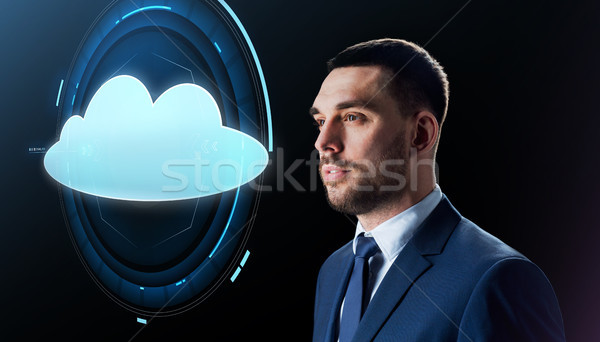 businessman over black with cloud projection Stock photo © dolgachov
