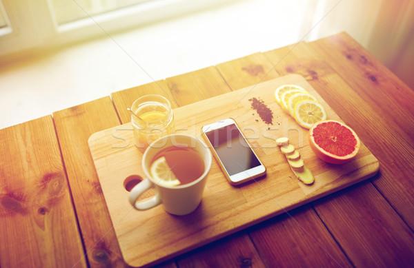 Okostelefon csésze citrom tea méz gyömbér Stock fotó © dolgachov