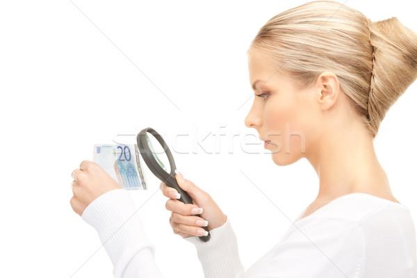 Donna lente di ingrandimento soldi faccia euro femminile Foto d'archivio © dolgachov