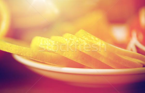 close up of lemon slices on plate Stock photo © dolgachov
