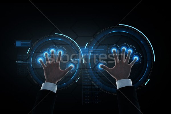 businessman hands with virtual projection Stock photo © dolgachov