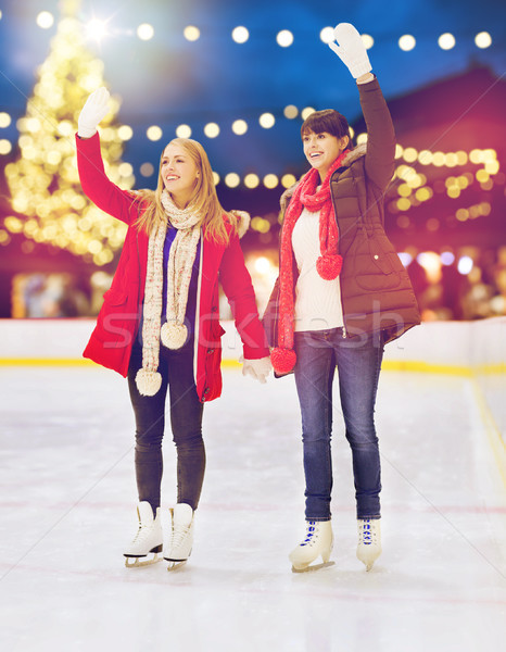 Stock photo: women waving hands at christmas skating rink