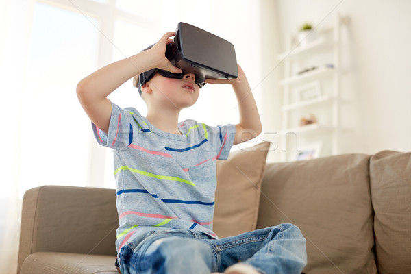 little boy in vr headset or 3d glasses at home Stock photo © dolgachov