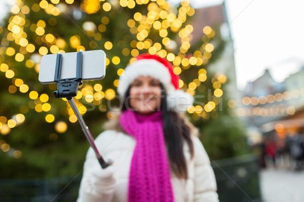 Donna smartphone Natale vacanze tecnologia Foto d'archivio © dolgachov