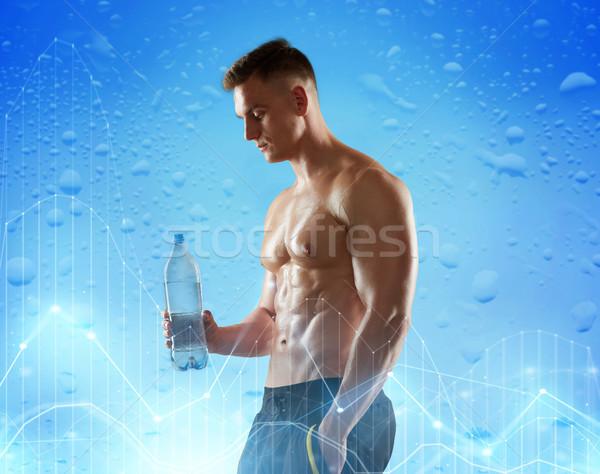 молодым человеком Культурист бутылку воды спорт Сток-фото © dolgachov